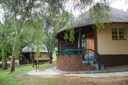 Badplaas, A Forever Resort | Holiday destination near eManzana and Carolina | leisure, corporate, conference, weddings, hotel, accommodation, health hydro, spa, water park | Mpumalanga | South Africa: 4-Sleeper Rondavel. 2 bedrooms (4 single beds)
